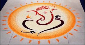 Rangoli of Lord Ganesha within sun rays